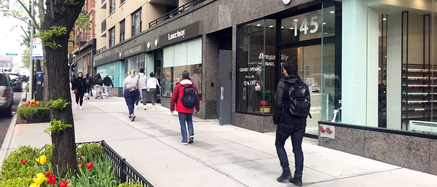 Pedestrians stroll along Amsterdam Ave between 66th and 67th Streets