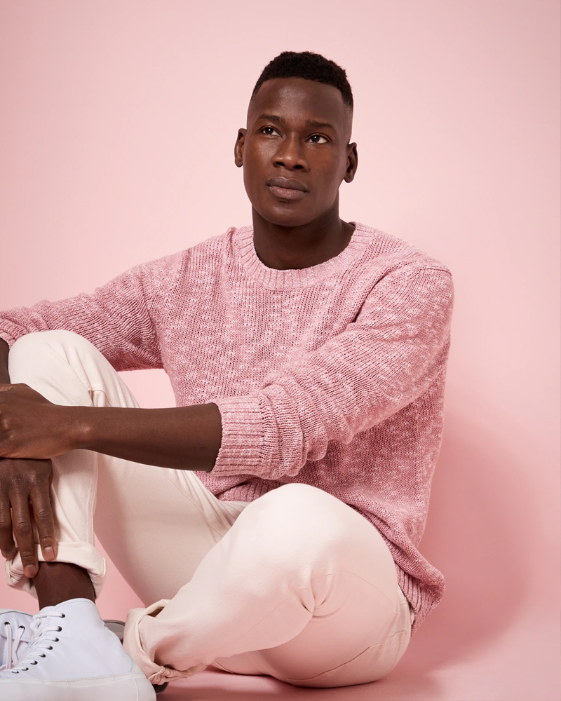 a young man on a pink background in a pink sweater and pink slacks from Banana Republic's spring 2021 collection