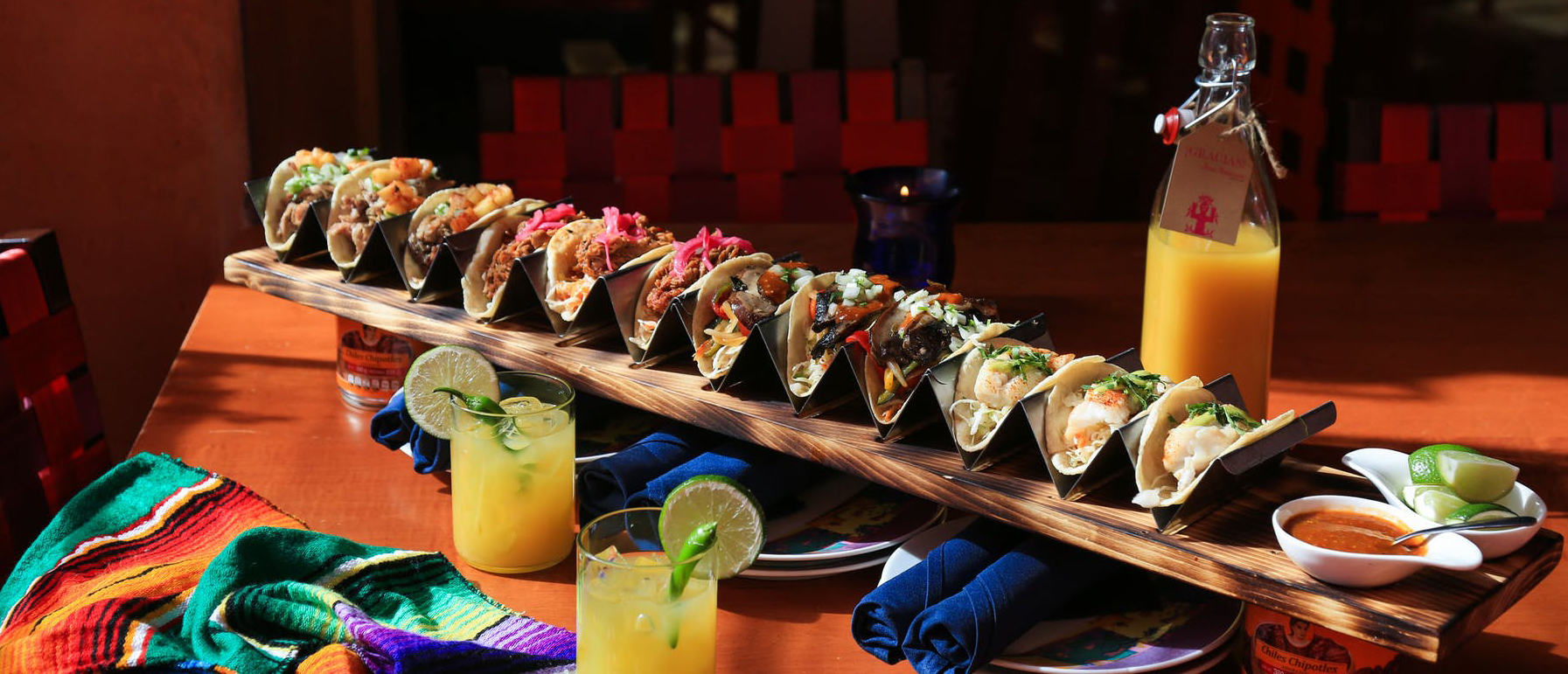 long row of tacos with special cocktails at Rosa Mexicano