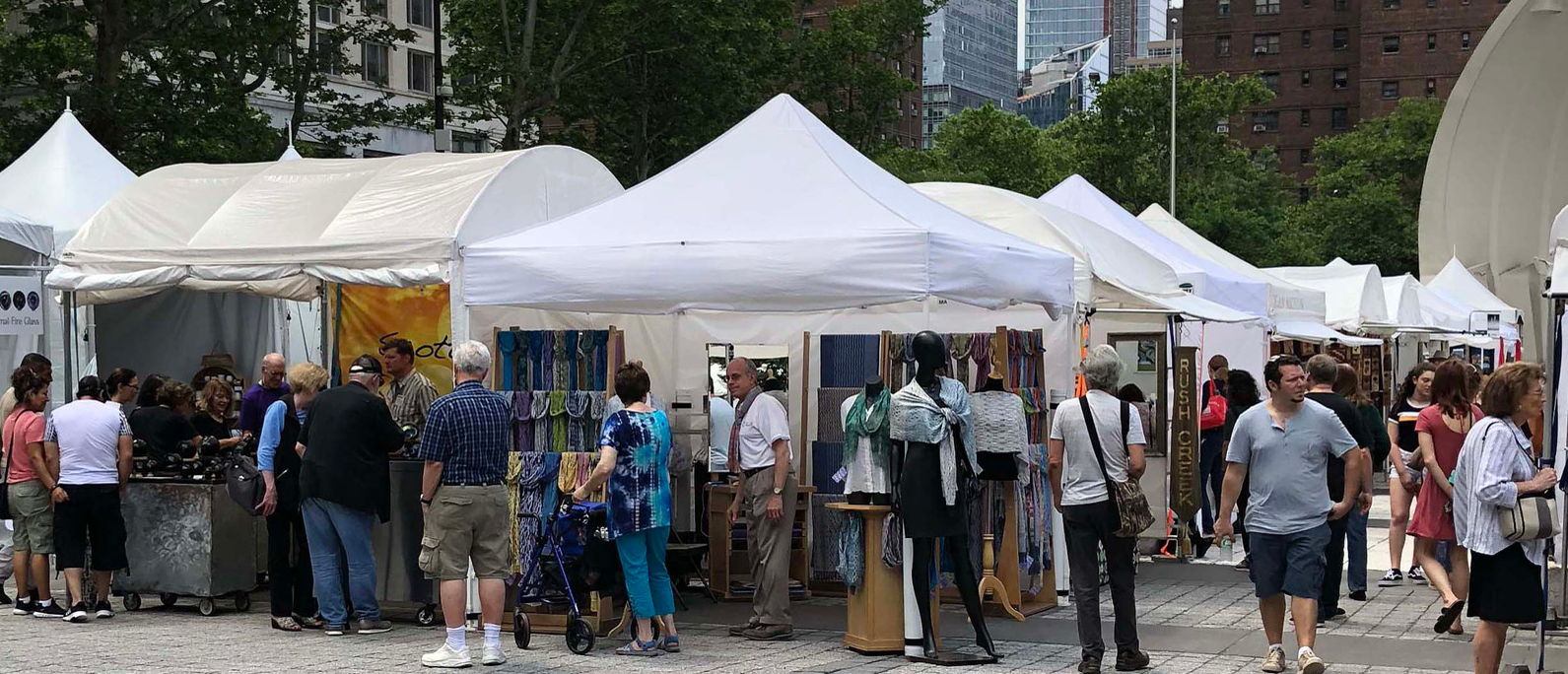 Guests browse vendor stalls in Damrosch Park for CraftNewYork
