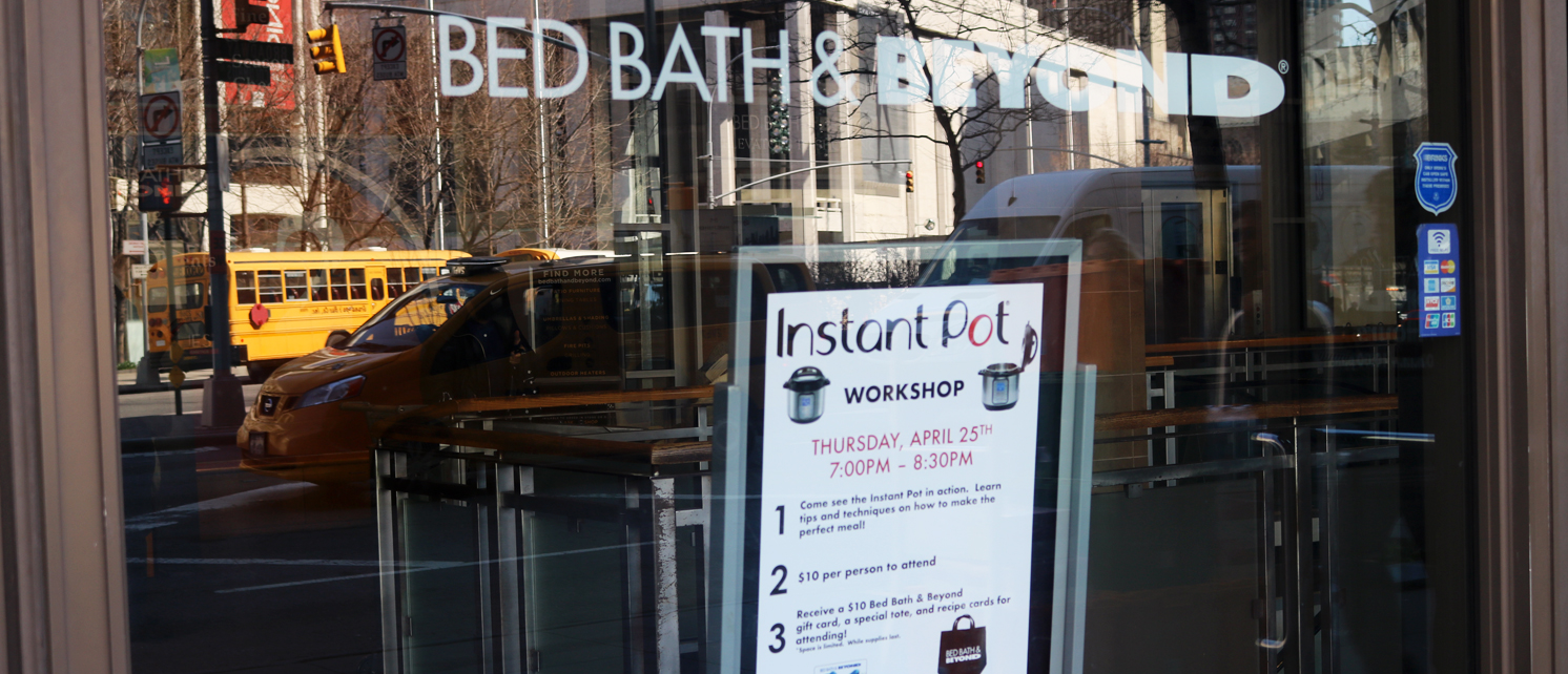 Photo of local Bed Bath and Beyond_s window with a sign for the Instant Pot Workshop event