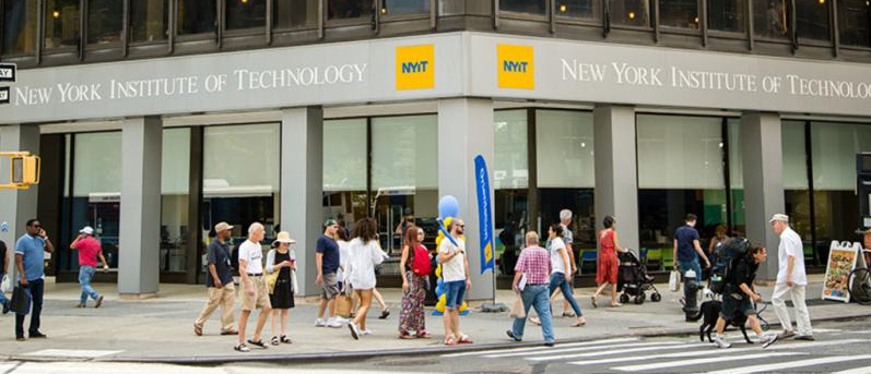 Students and pedestrians pass by the main entrance of NYIT on Broadway and 61st Street