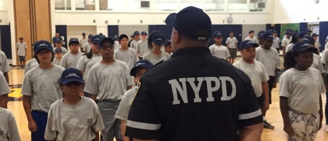 Summer Youth Police Academy cadets gather in a gymnasium