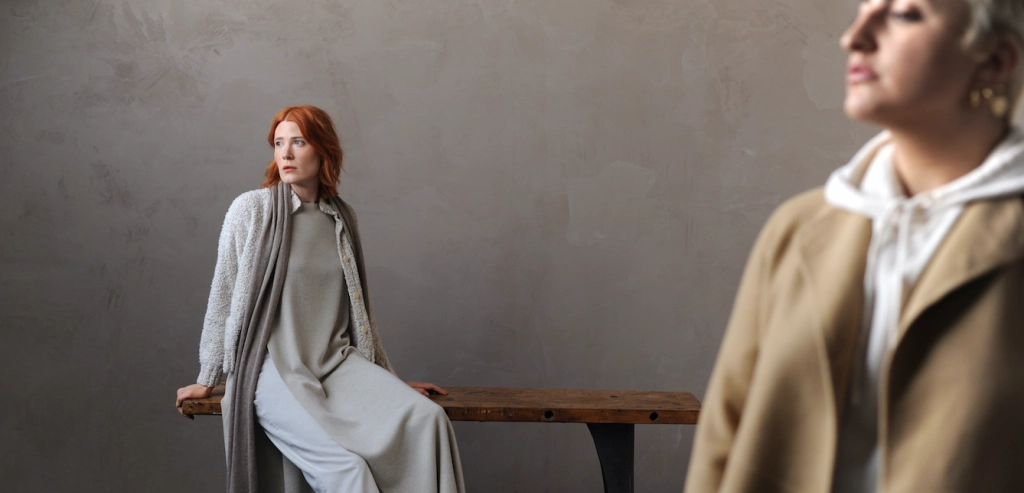 two women pose in clothes from Eileen Fisher's spring 2021 collection in a grey set