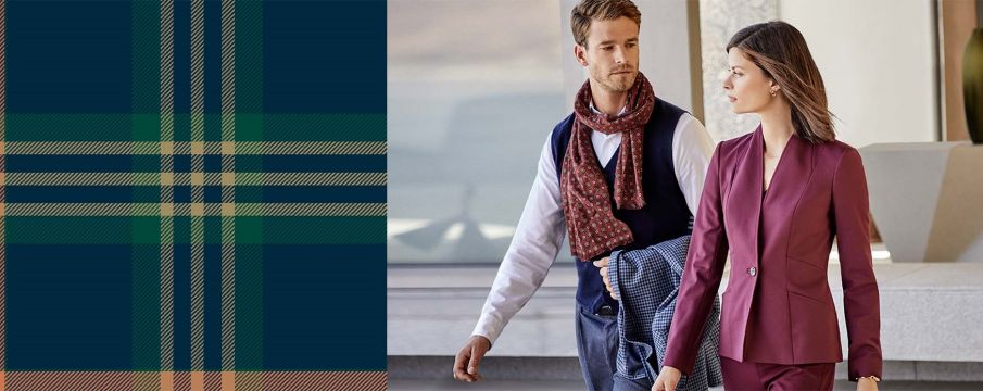 man and woman in Brooks Brothers clothing pose for an ad for fall
