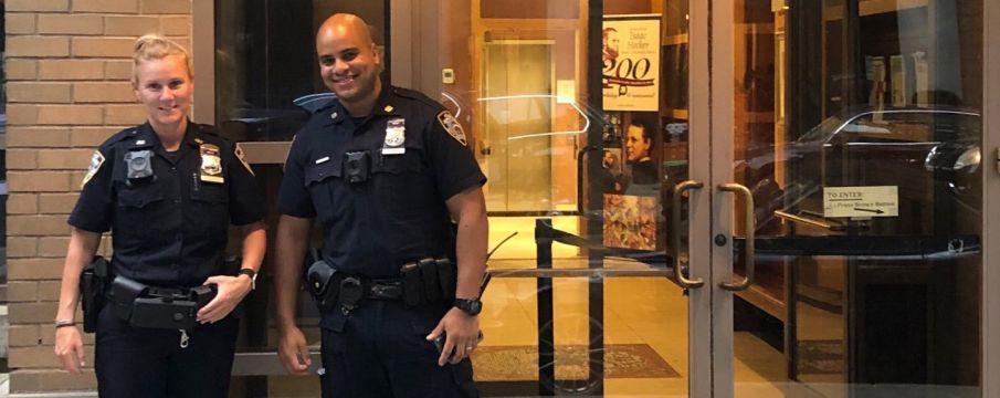 Neighborhood Coordination Officers Fanning and Vasquez pose in uniform