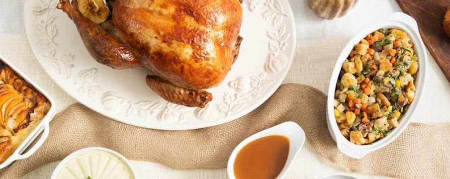 table set with turkey, stuffing, and gravy from Epicerie Boulud