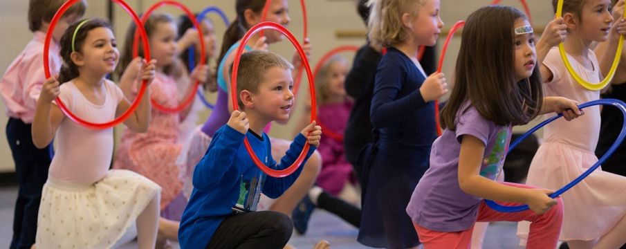 kids play with hula hoops at the NYC ballet