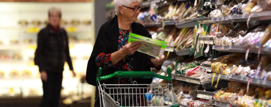 an older woman shops for groceries