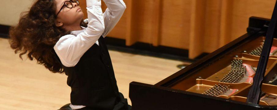 young boy playing piano