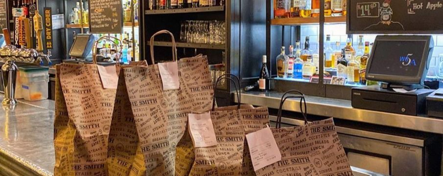 bags for take out line the counter of The Smith in Lincoln Square