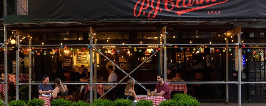 people dining outside pj clarke's