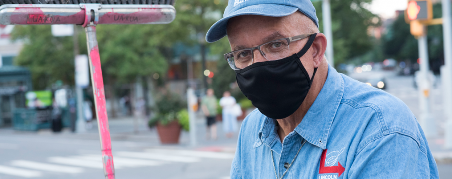 Close up of clean Team Member Carl wearing a black face mask