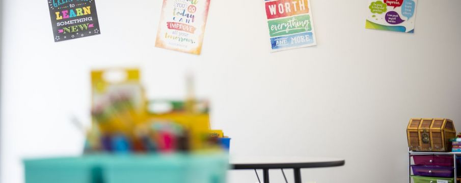 classroom space with tables and posters