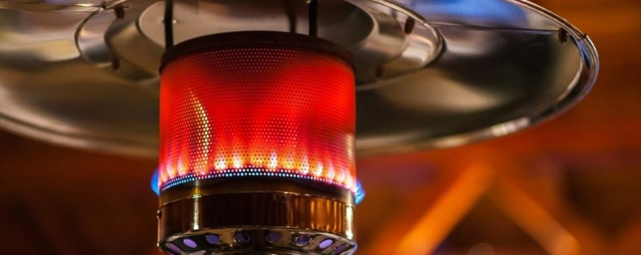 close up of the top of a standing outdoor patio heater