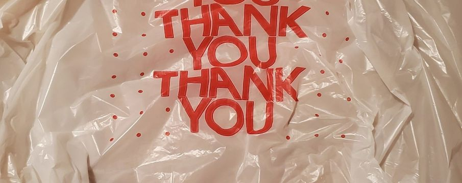 plastic bag with the words THANK YOU printed on it in a repeating pattern