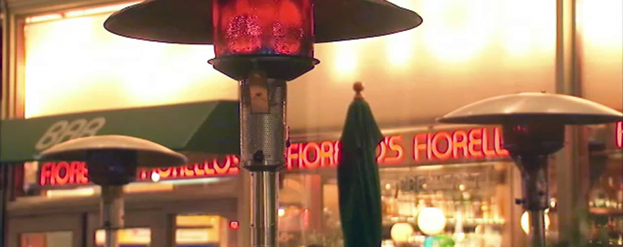A close up of heaters at Cafe Fiorello's outside sidewalk seating