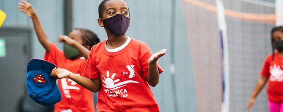 kid wearing mask at ymca camp