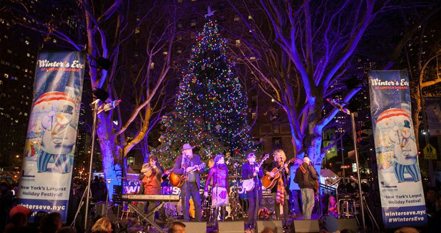 A band plays on-stage in Dante Park during Winter's Eve